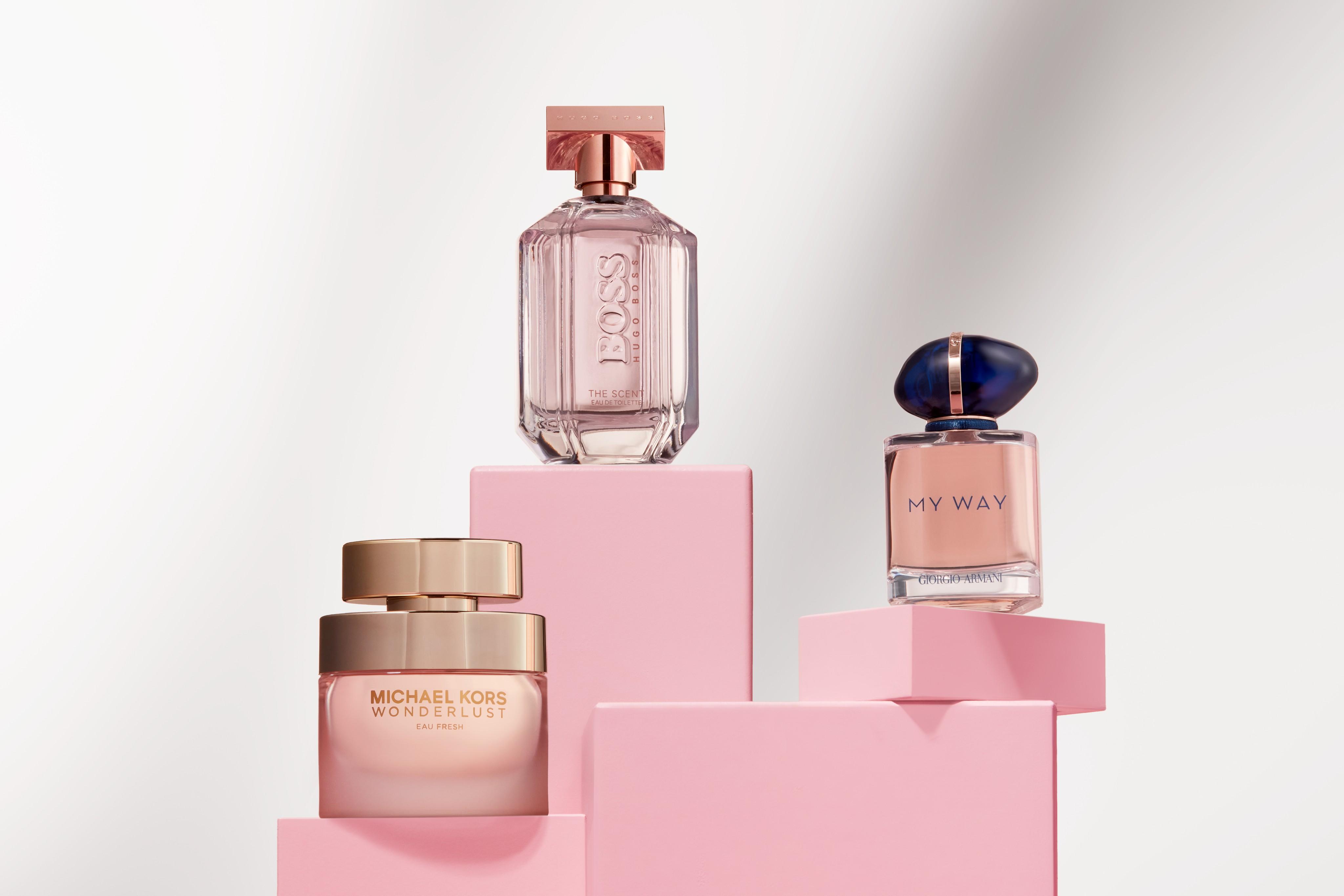 Fragrance-female-product-michaelkors-armani-hugoboss-pink-cubes-white-room-horizontal-unlimited-Web-Rendition
