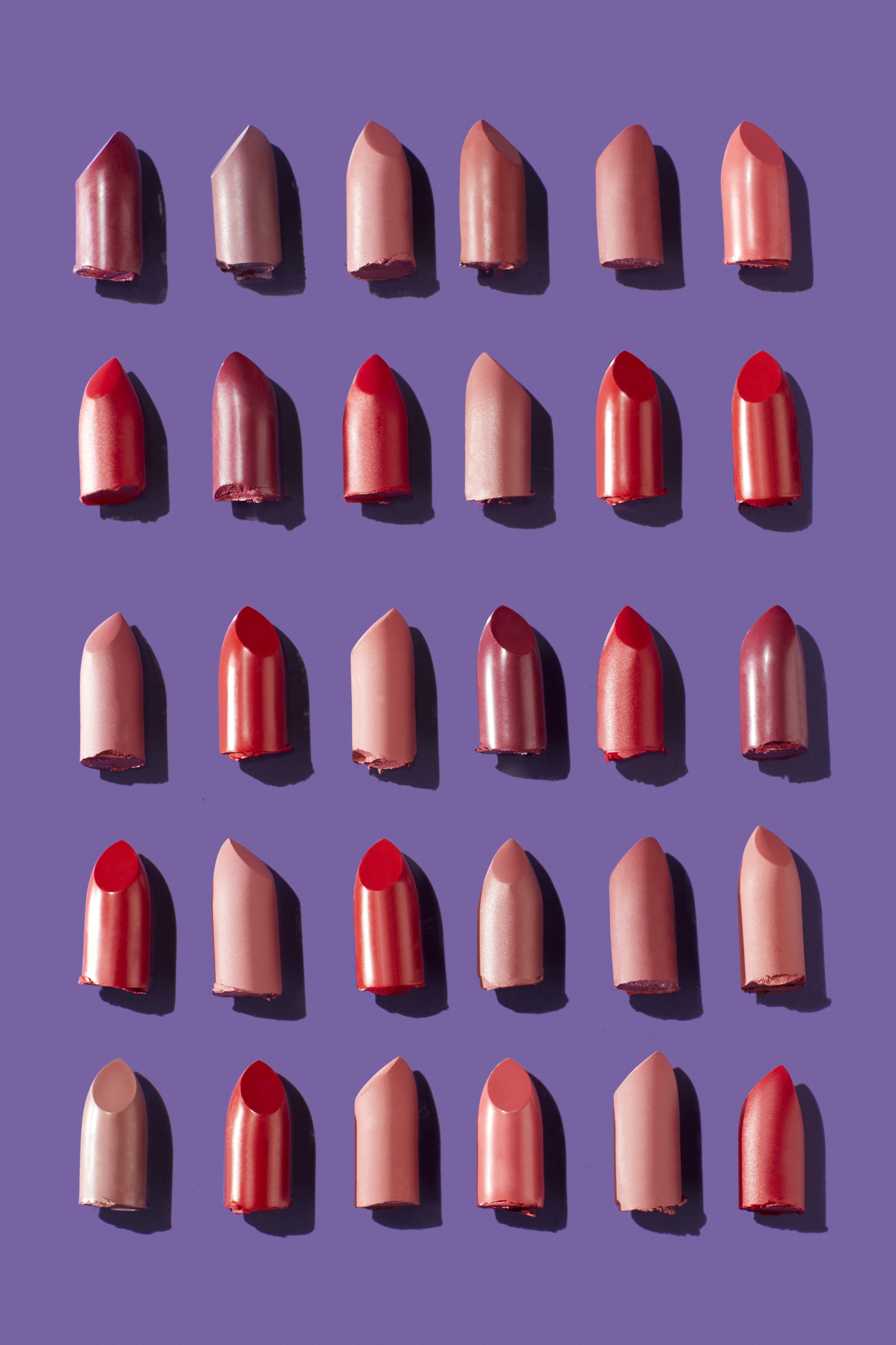Makeup-product-ubranded-lipstick-heads-different-colors-purple-background-editorial-unlimited-Web-Rendition