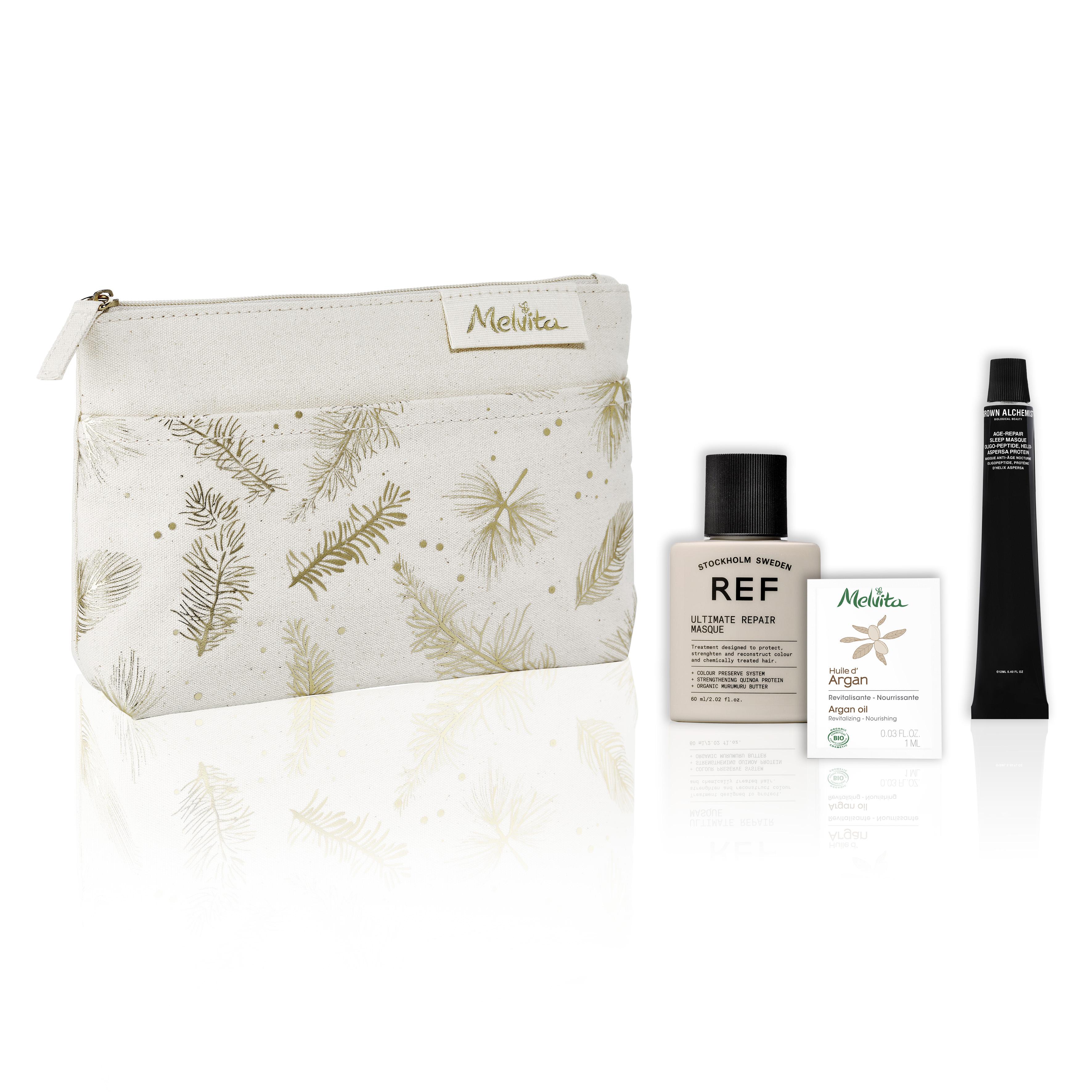 Kosmetická taštička Melvita s produkty Grown Alchemist, REF v cestovním balení a vzorkem bio arganového oleje od Melvity.