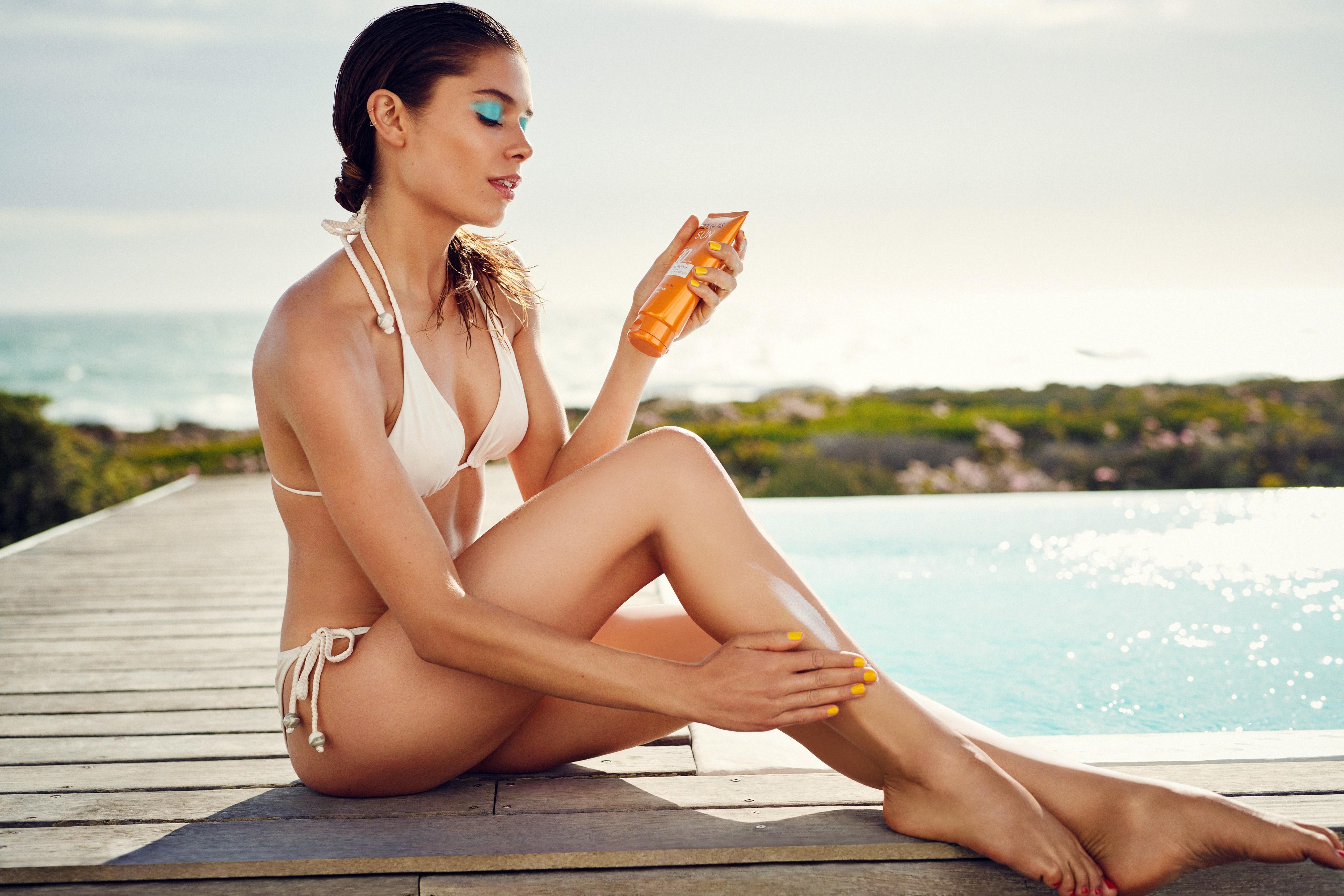 Skincare-beautyvisual-spf-woman-white-bikini-yellow-nails-blue-eyes-062022-Web-Rendition